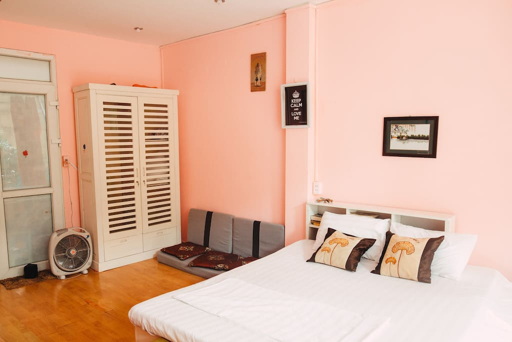 Pink room with the white furniture