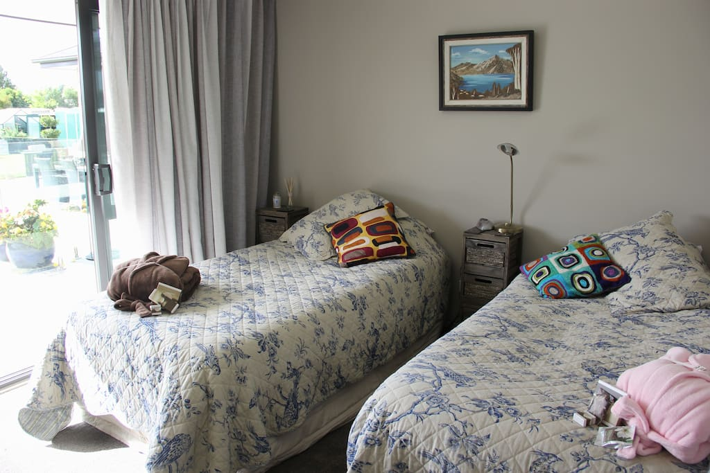 Ashley room with pool & garden view. Super single twin beds. Shared bathroom with spa bath.