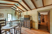 Relax amidst antiques and vaulted, paneled ceilings.