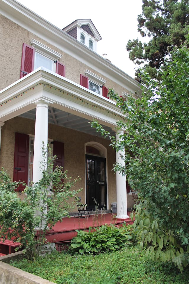 colonial style home with large front porch