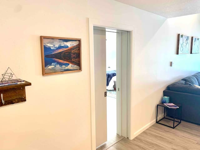 Head into your master bedroom that overlooks beautiful downtown Bigfork, Flathead Lake and the majestic Swan Mountain range.