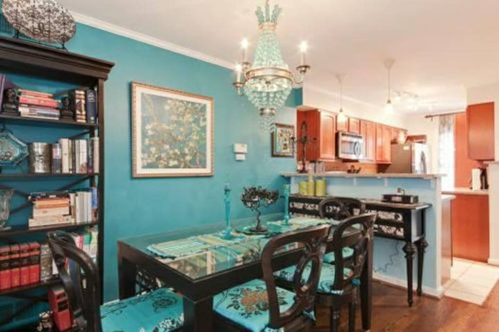 Formal dining area comfortably seats 6 guests.