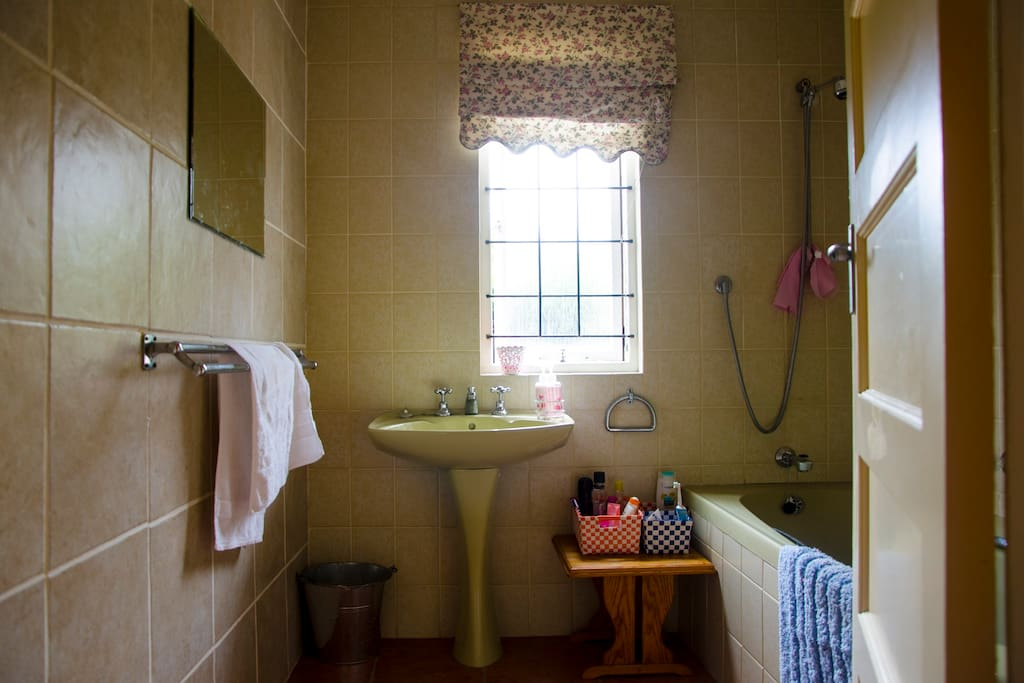 a nice clean bathroom for guest use complete with bath and shower mechanism