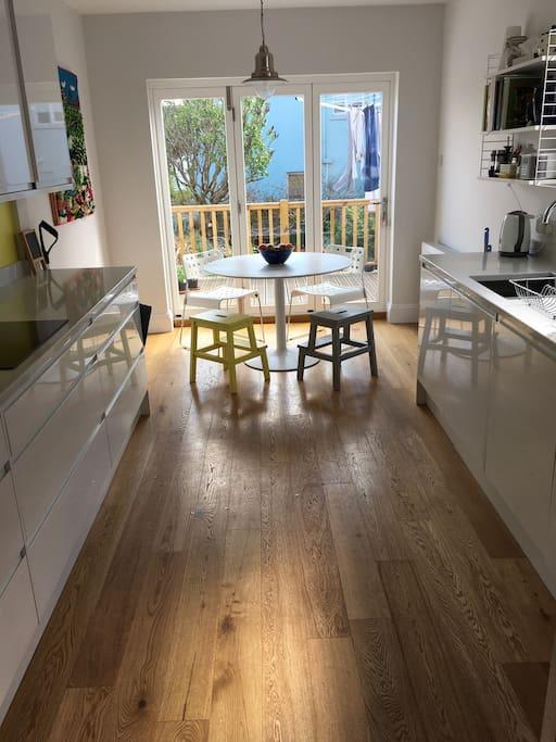 Kitchen with bi-fold doors onto garden terrace