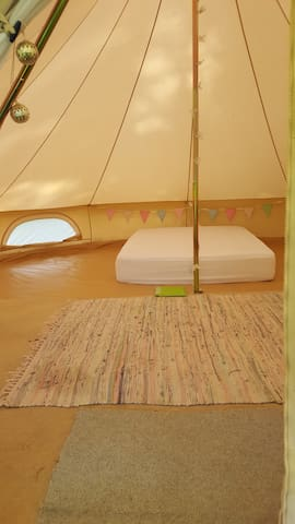 Each bell tent comes with a double mattress, rugs, fairy lights and an information folder