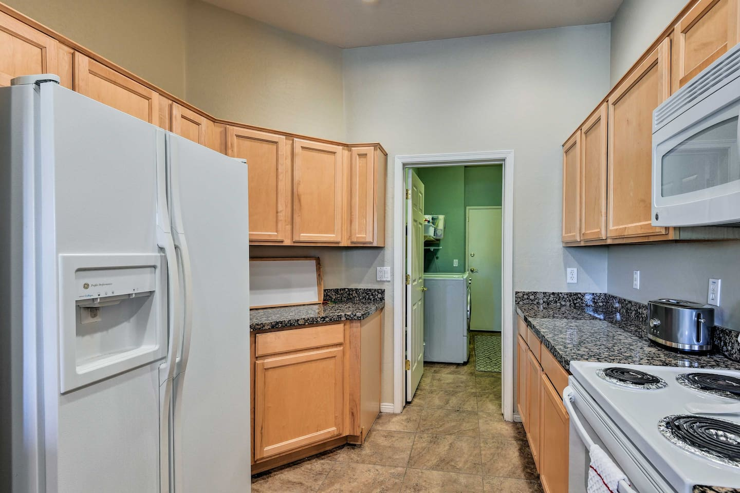 A fully equipped kitchen invites you to whip up your favorite dish!