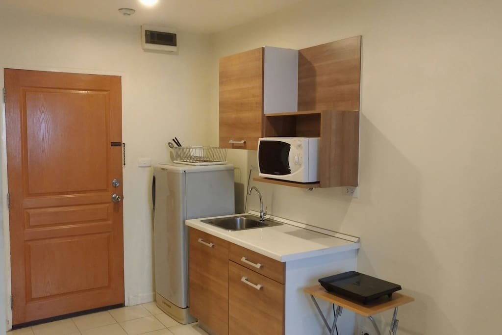 nice kitchen with bits you need kettle ok fridj toaster microwave some cooking basics better than hotel as have wash machine and line in condo in best spot to explore Bkk asok sukhumvit aria