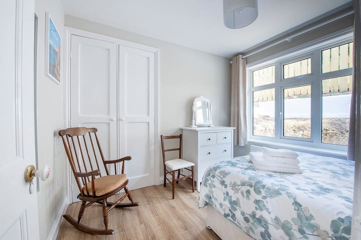 The second double bedroom with plenty of storage space and natural light. Luxury linen and towels are provided for your stay.