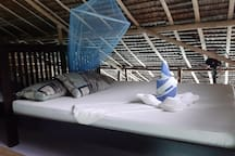 double bed in the mezzanine/mansarde