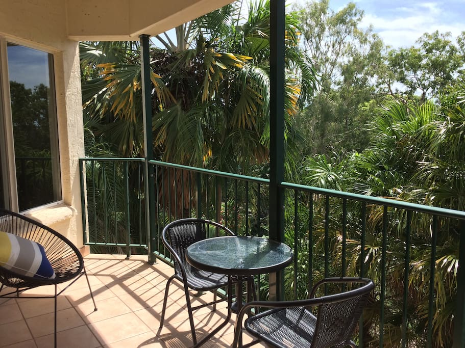Enjoy  a cold beverage on the balcony overlooking the botanical gardens