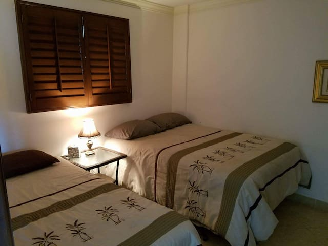 Second bedroom, with full and single bed