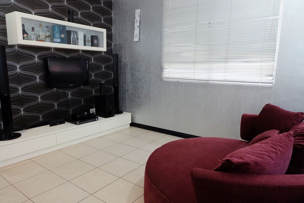 TV/ living area with a comfy couch
