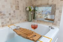 Enjoy a RELAXING WHIRLPOOL with a glass of wine while watching tele.