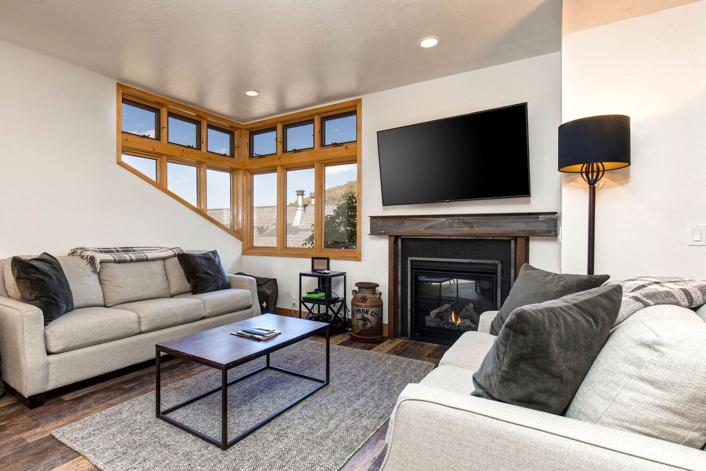 """Cozy Main Level Living Room with a Gas Fireplace and 65"""" Smart TV"""