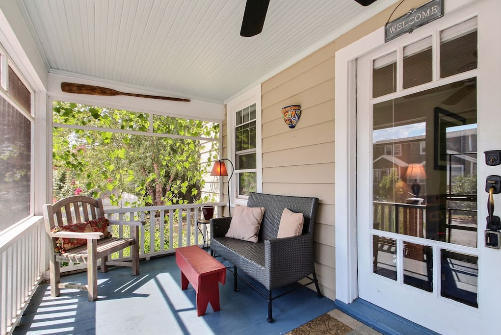 Our home boasts 4 porches - front, master, back, game house. This is the front porch! Catch the cross breezes and enjoy your first cup of coffee and read the paper here!
