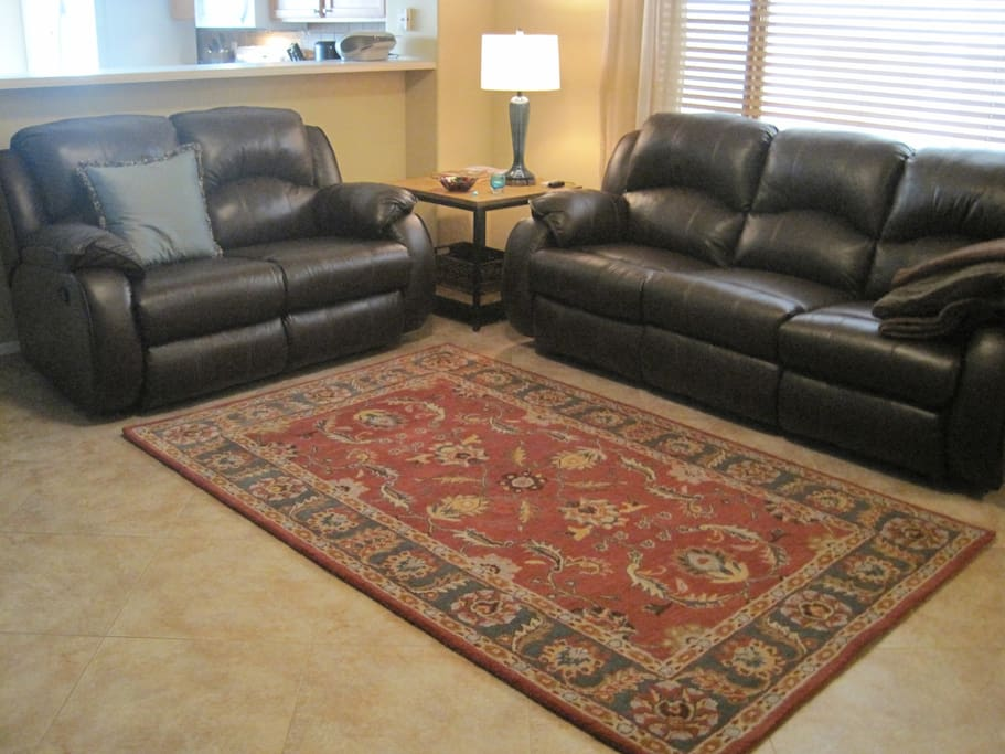 "Great Room with Reclining Leather Sofas, and a 55"" flat screen tv offer casual comfort."