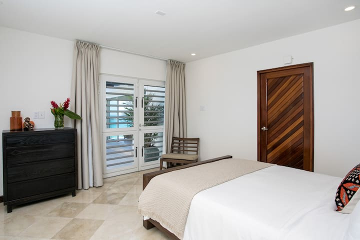 The junior bedroom suite is very spacious and has a magnificent outlook from which you have direct access to the outdoor porch and views of Great Bay harbor.