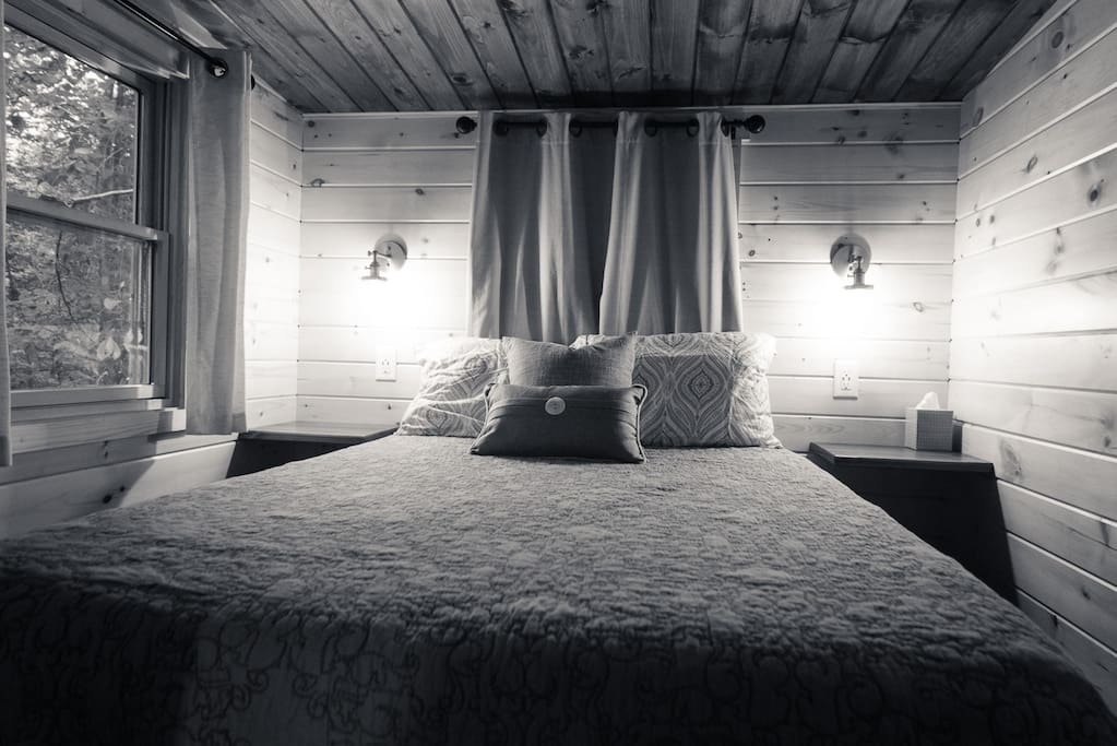 Enjoy your bed nestled in the forest in a room you can stand up in! At the entrance the ceiling is 6 feet tall, gently sloping downward as you reach the head of the bed.
