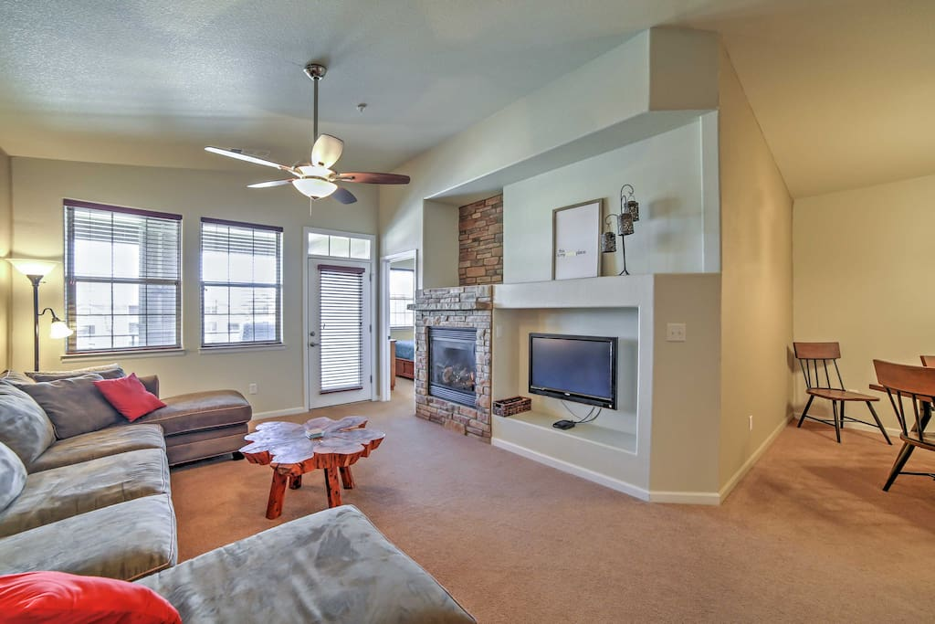 The living room features a large, plush sectional, gas-burning fireplace and a flat-screen cable TV.
