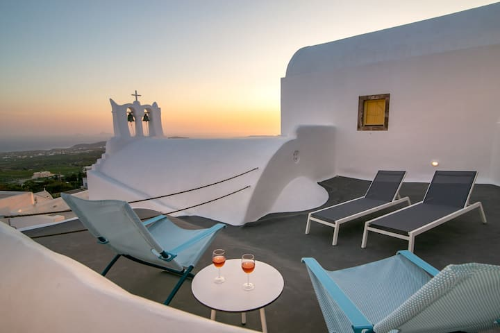 The roof top terrace has grandstand views over the village with Santorini's blue domed churches. This space is just for you 2!