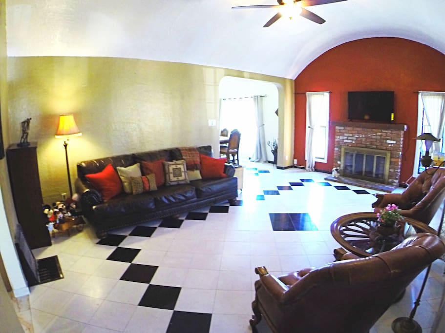 """Living room area with comfy couches and 50"""" smart TV"""