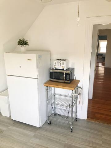 Full sized refrigerator with microwave and toaster