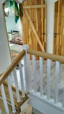 3rd floor living room door, stairs and next door bathroom entrance
