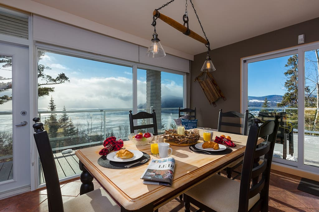 Dining area with views of the St. Lawrence, Baie-St. Paul and the mountains