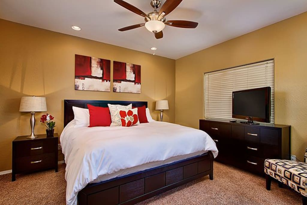 Spacious master suite with TV.