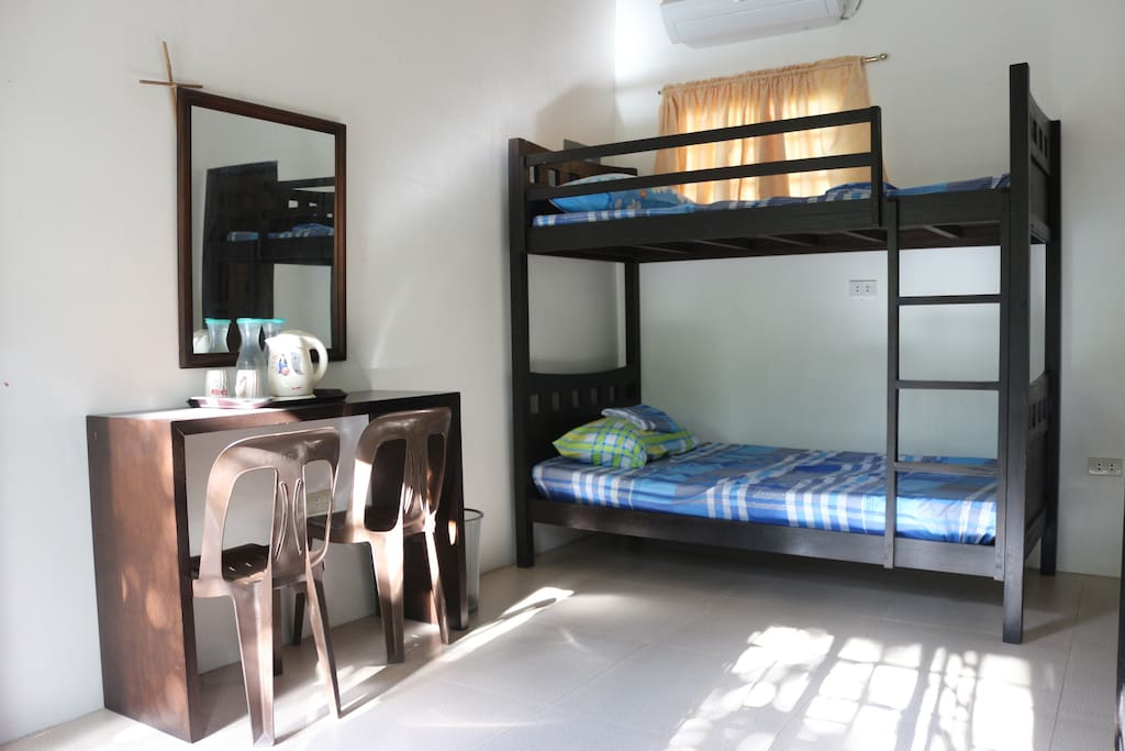 Interior: Bunk bed near the side table