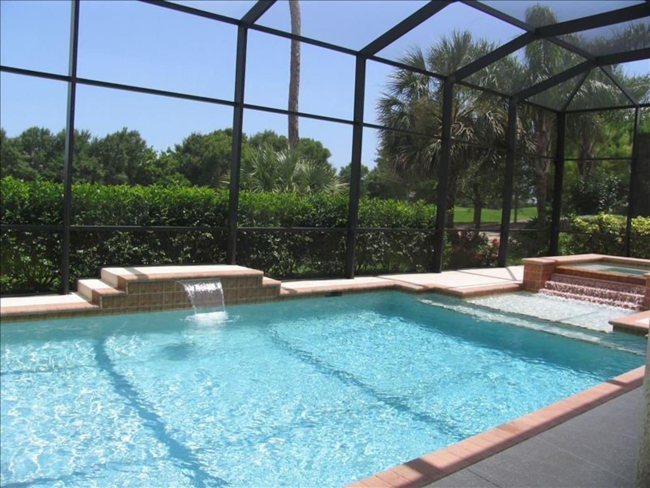 Lely Resort home w/ private heated pool w/ cascading waterfalls, sunshelf, and 8-person hot tub