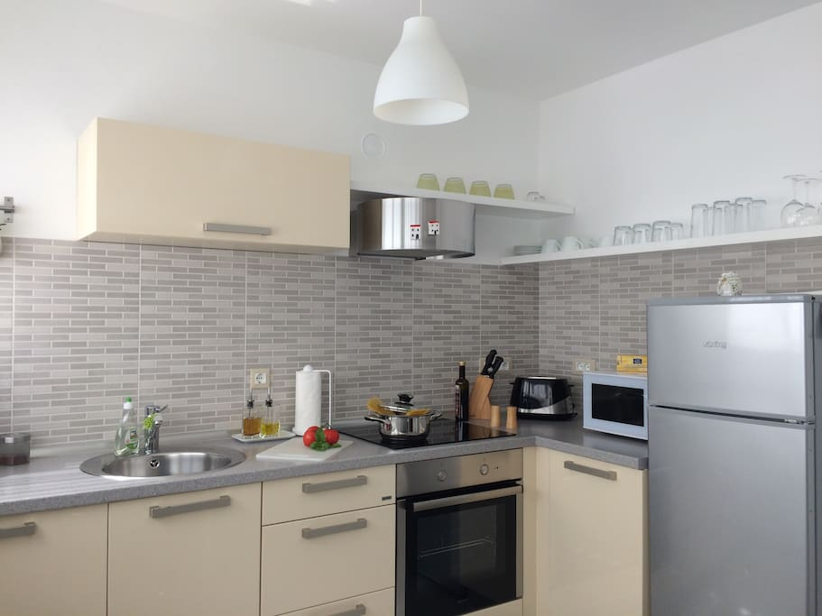... a fully equipped kitchen includes ...