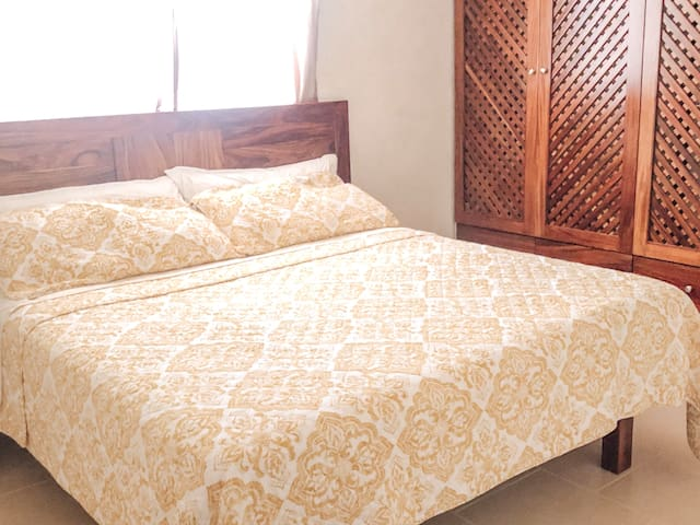 Main bedroom with a custom made brand new king sized bed with a very comfortable mattress.
