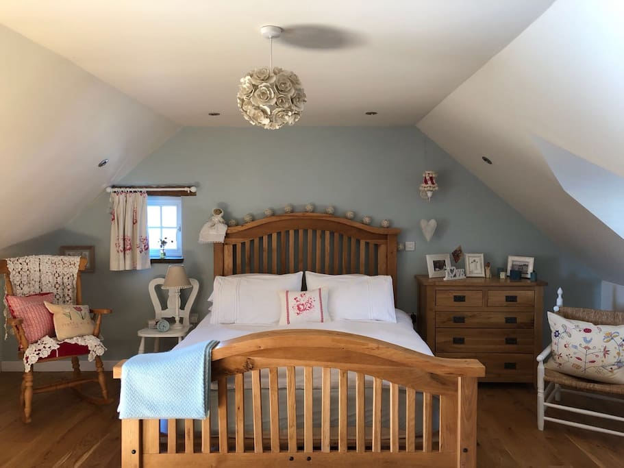 The Master Country Room - King size bed with large living space. Internet TV within the room and bathroom next door