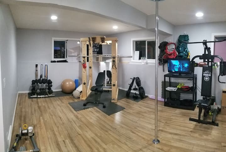 Cozy bedroom, private bathroom, home gym.