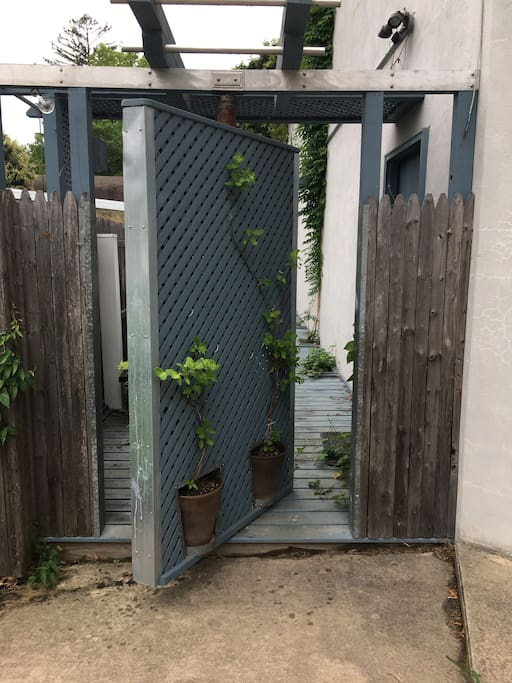 Rotate gate door to enter patio.