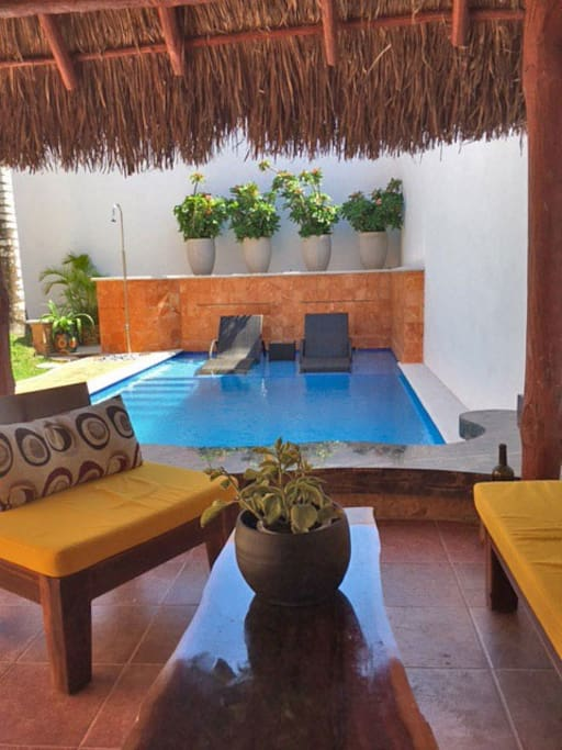 The swimming pool as seen from the palapa covered patio