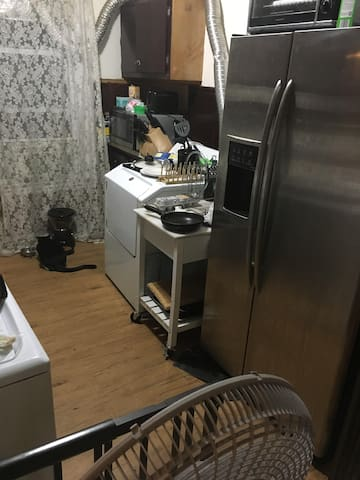 The kitchen is a shared space. You are welcome to prepare meals as long as you clean up after yourself, and store personal food in the mini fridge in your bedroom.