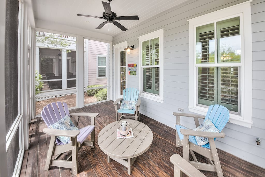 Relax on a screened-in porch at the front of the home.