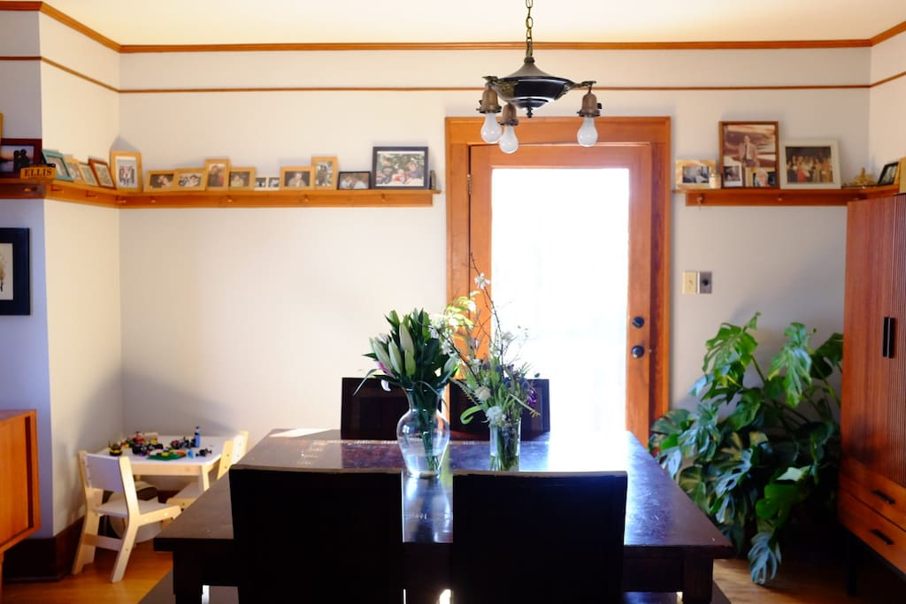 Dining room: Two benches and four seats, small child's table, door to backyard.