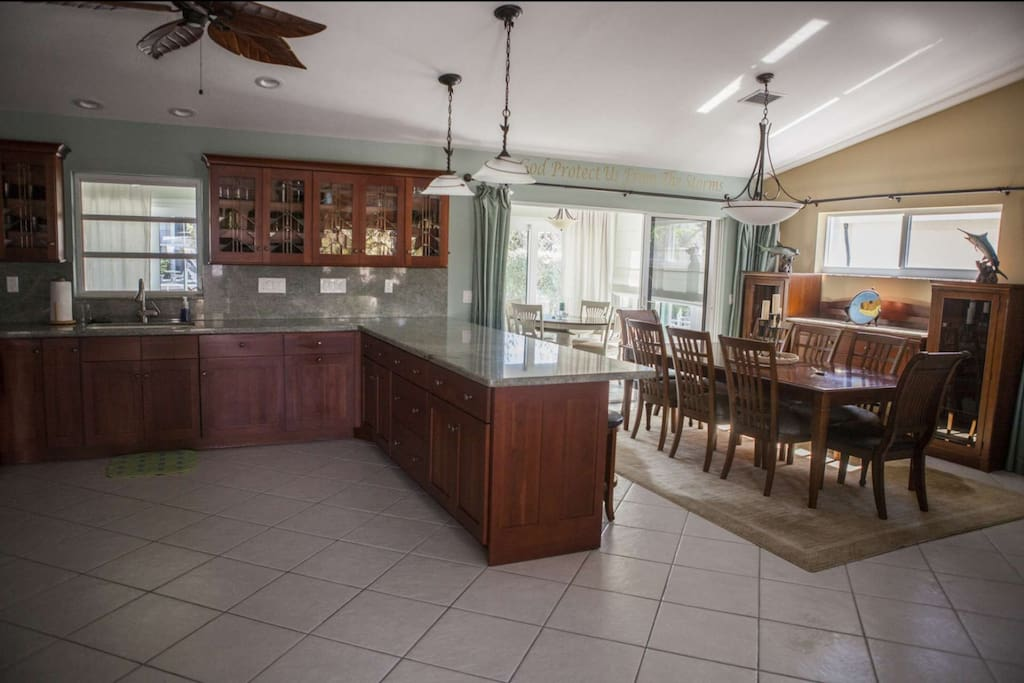 Large gourmet kitchen with ample counter space and all items necessary to prepare and serve a meal.
