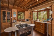 Quality crafted kitchen overlooking the bushland. It features a large gas oven and cooktop, microwave and coffee machine with locally handmade cupboards.
