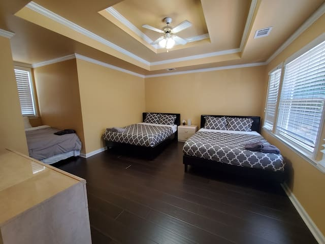 Master bedroom with 2 queen beds and a twin bed