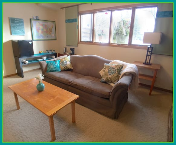 """Living/family room. Come add your location to our map! Coffee & tea makings always available, and mini-fridge. ..... """"This was a fantastic place. The pictures don't even do the place justice.""""—Lisa-3-17"""