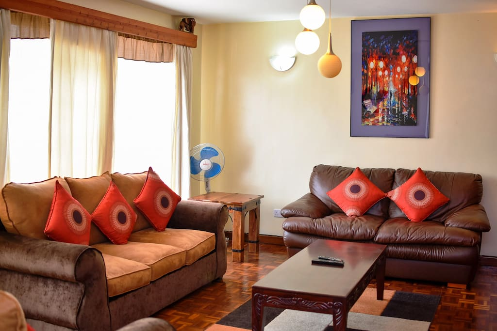 Massive living room with very comfortable sofas and beautiful wall art