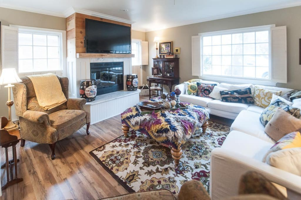 """Living area w/fireplace, 55"""" flat screen & seating for everyone!"""