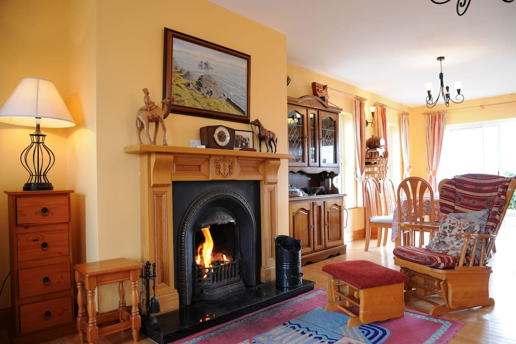 Relax on the rocking chair by the fire place.