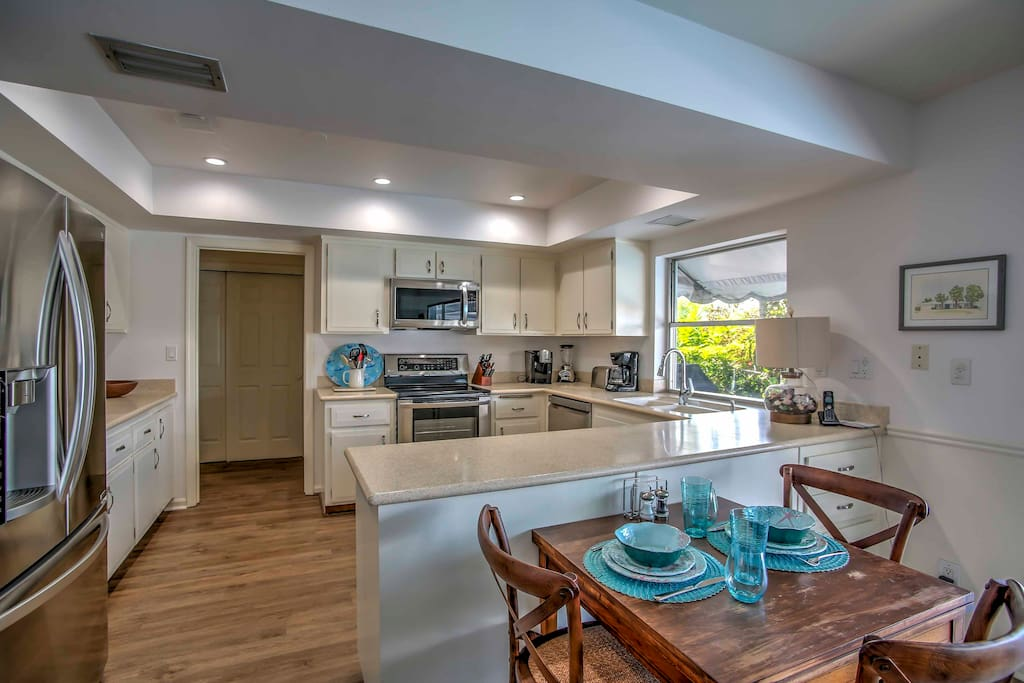 Prepare home-cooked recipes in the fully equipped kitchen that features stainless steel appliances and spacious countertops.