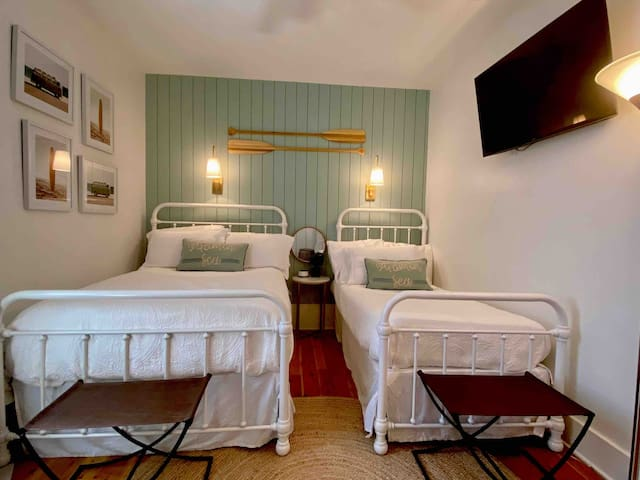 The second bedroom has been newly updated. This room is so pretty you will enjoy peaceful nights. This includes a queen bed and a twin.