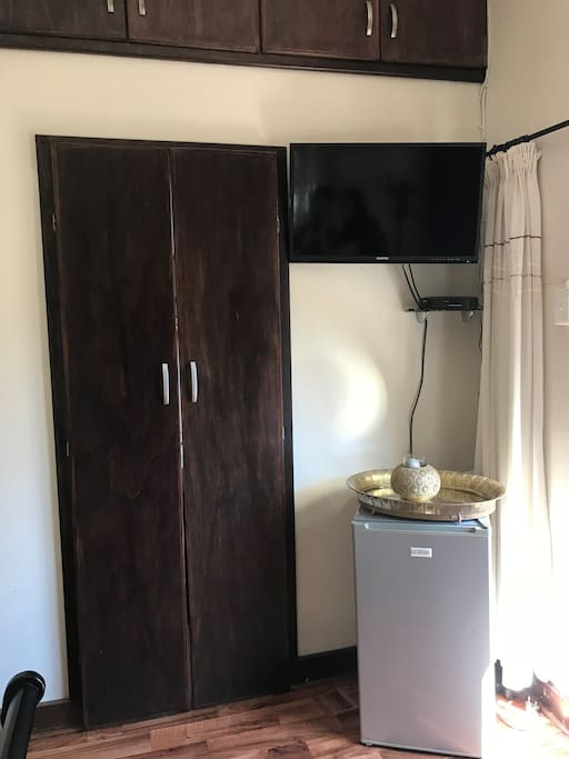 """Hidden"" Bathroom, TV & Mini Fridge"
